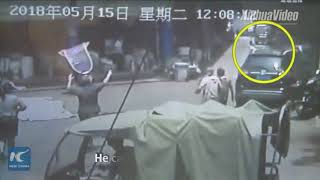 Man catches girl that falls from second-floor window in China
