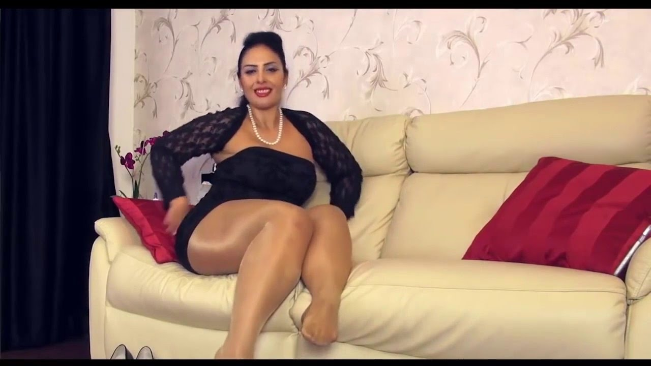 arab mature female and her erotic legs in nylon shiny pantyhose