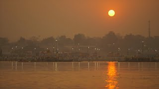 Sunset view at Kumbh festival with sun reflection in the water of the Ganges
