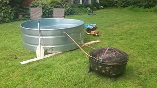 Off-grid DIY wood-fired stock tank hot tub