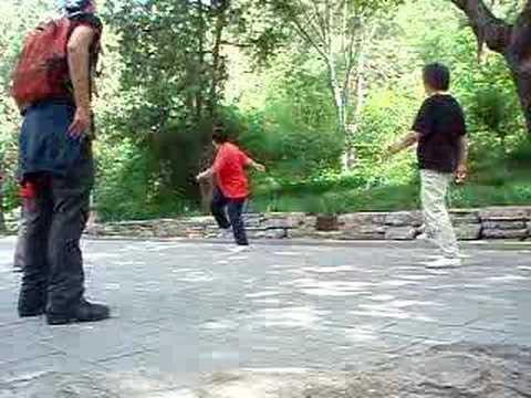 Tim plays hacky sack with old chinese ladies in Beijing park