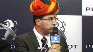 French car company officials talk with media persons at Sanand
