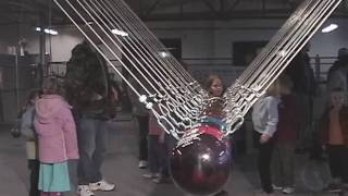 Giant Newton's Cradle With Bowling Balls