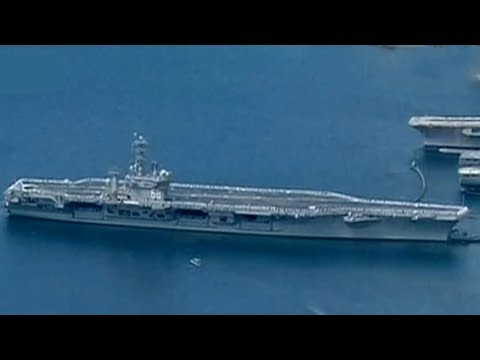 Japan joins three US aircraft carriers in drills