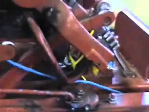 how the knotter of square baler works.wmv