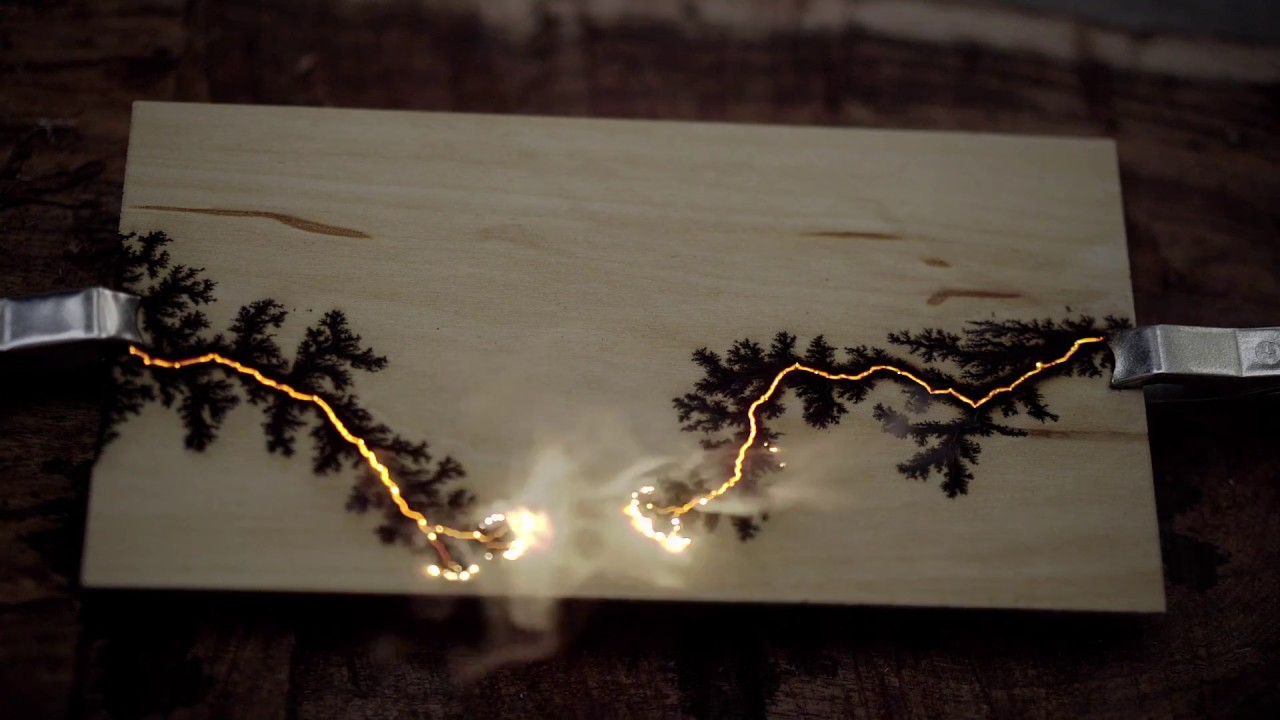 burning wood with 2000 v lightning lichtenberg figures youtube