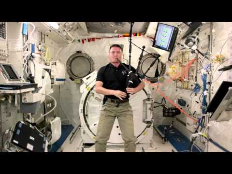 NASA astronaut Kjell Lindgren plays Amazing Grace on the bagpipes