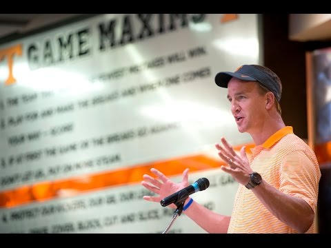 Peyton Manning delivers scholarships, talks about retirement