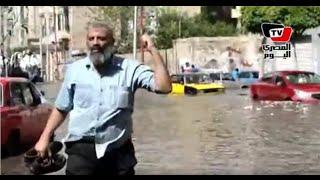 مشاهد من تعامل أهالي الإسكندرية مع الأمطار