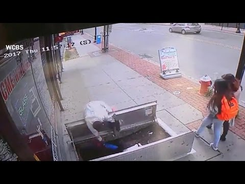 Woman distracted by cell phone plunges down open cellar door
