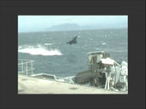 Jet Fighter Low Pass Fly By French Dassault Rafale Plane in Near Miss Aircraft Flies over Sea Water