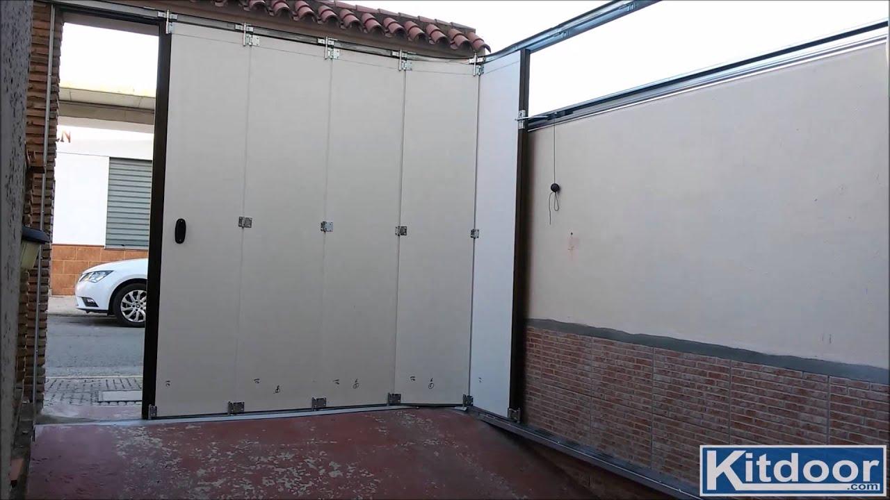Puerta seccional lateral KITDOOR vista desde dentro con automatismo ...