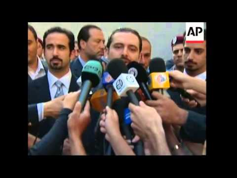 Polls open, Hariri's son, widow voting