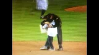 Army father dresses as umpire to surprise son during Safeco Field homecoming