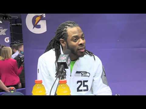 Richard Sherman gets into a debate with a reporter