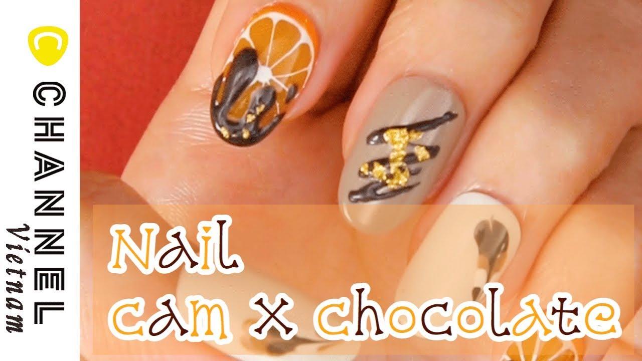 Mẫu móng tay cam sốt chocolate 🍊