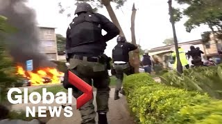 Dramatic footage shows Kenyan security forces storming hotel during terrorist incident
