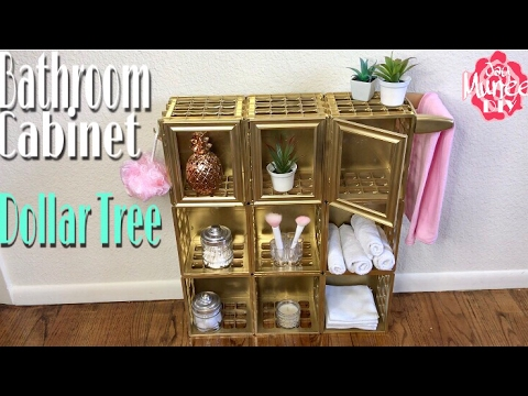 Dollar tree diy bathroom storage cabinet youtube for Bathroom decor dollar tree