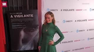 Video: Olivia Wilde sparkles in a green gown at 'A Vigilante' premiere