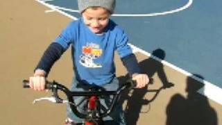 4 year old does tricks on bmx bike