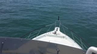 70 Ocean Cockpit Motor Yacht Leaving Inlet