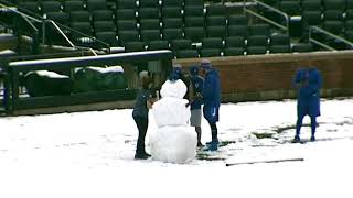 Mets players build a snow man at Citi Field