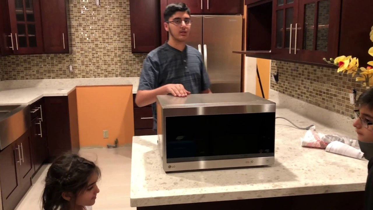 1 5 cu lg microwave unboxing and review does it cook