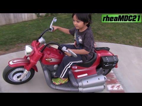 Riding His Harley Davidson POWER WHEELS :-)