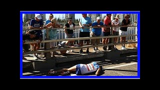 Leader collapses near finish of Commonwealth Games marathon By J.News