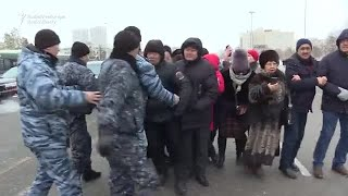 Protesters Dragged Away By Kazakh Police After Activist's Death