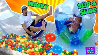 GIANT BUBBLE BALL SLIP AND SLIDE FOR KIDS IN OUR BACKYARD! FUNNY FAILS WITH PARENTS! WUBBLE BALL PIT