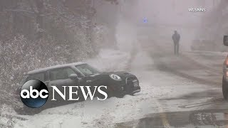 Snow, heavy rain, winds slam Midwest to East Coast | ABC News