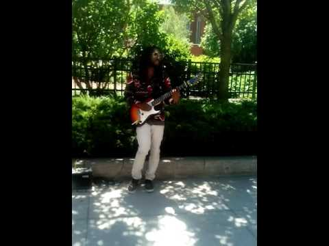 Guy Still Playing Guitar on Court Street in Rochester, New York, June 14th, 2016