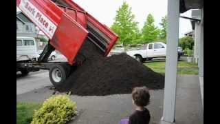 Dump Truck dumping dirt