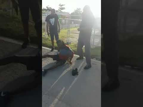 Police as they arrest a man for assaulting woman with hammer