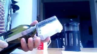 Remove (BottleLox) security device from bottle using a kitchen knife