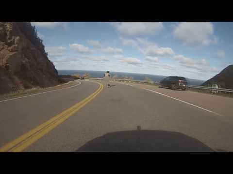 Daring Man Skateboards Downhill Naked