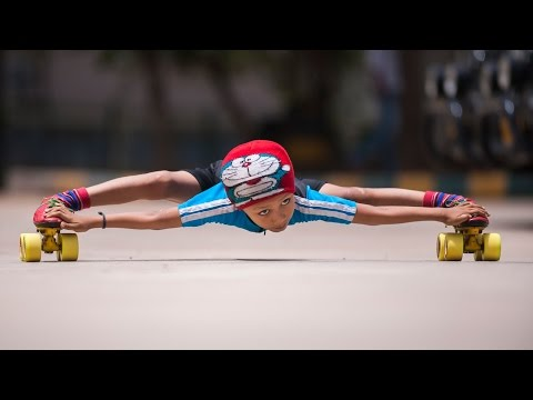 Record Breaking Limbo Skater: 6-year-old Skates Under 39 Cars