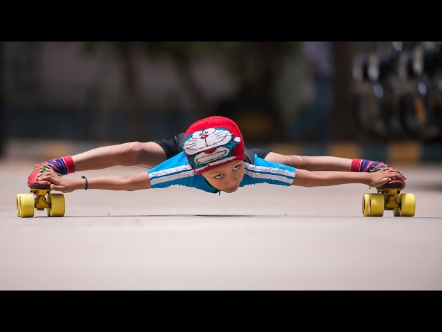 Record Breaking Limbo Skater: 6-year-old Skates Under 39 Cars