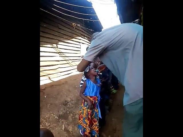 Kikera Slum Children Receiving Malaria Medicine