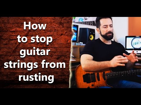 How can I stop my guitar strings from rusting quickly? INT 015