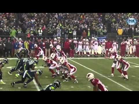 Seahawks Head Coach Pete Carroll teaches rugby tackling