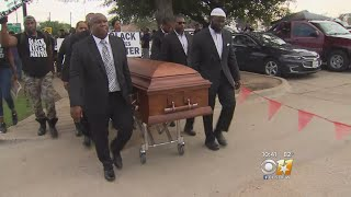 Protesters Holding Caskets March Near AT&T Stadium For Police Shooting Victims