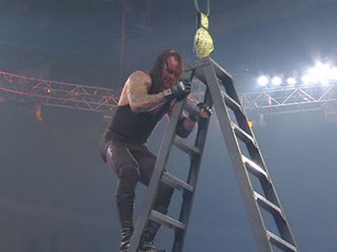 Edge defeats The Undertaker in a TLC Match, banning him