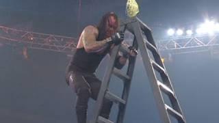 Edge defeats The Undertaker in a TLC Match, banning him