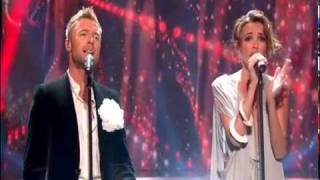 Nadine performs with Boyzone on
