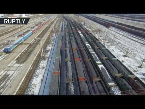 Drone captures endless lines of coal cars held up by blockade of rebel E. Ukraine