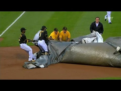 Baseball Players Rescue Groundskeeper Caught in Giant Field Tarp