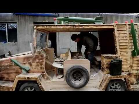 A fine piece of car-pentry: Chinese tradesman builds his own electric wooden vehicle