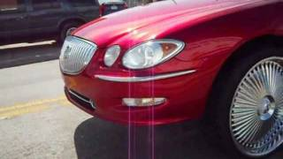"MHP- Candy Red Buick Lacrosse on 26"" Dub Bellagio Floaters"